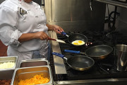 EGG-CELLENT SERVICE: A Culinary Arts student, above, prepares hot and fresh orders for The Student Chef restaurant.  PHOTO BY MIDORI MORITA