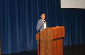 Keynote speaker Max Vargas speaking about his story of migrating to the United States as a child. Photo by Tyra Green