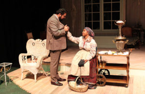 Navaz Khan as Astrov (left) and Imri M. Tate as Marina (right) in Delta Drama's production of Uncle Vanya during rehearsal on Feb 24 in the Al Muller Studio Theater. This scene opens the play. Photo by Vivienne Aguilar