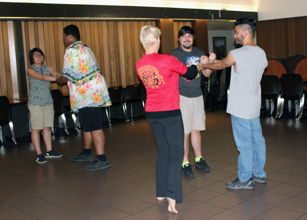 Delta students partner up to practice getting out of a wrist hold at the self defense class sponsored by Delta's Pride Club for Sexual Assault Awareness month.